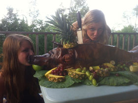 Girls kissing pig