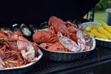 Lobster, corn, and baked potatoes ready to serve